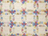 Queen Pastel Double Wedding Ring Quilt