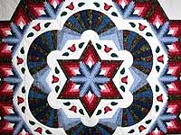 Blue and Rose Cathedral Star Quilt