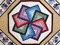 Multicolor Tan and Burgundy Star Spin Quilt