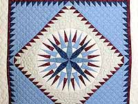 Blue and Burgundy Mariners Compass Quilt
