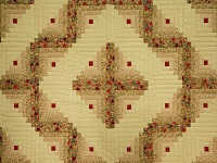 Red and Tan Log Cabin Quilt