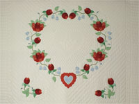 Heart of Roses Quilt in King Coral, paprika, blue and green on ivory