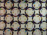 Plum Scrappy Double Wedding Ring Quilt