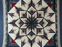 Blue and Red Starburst Quilt