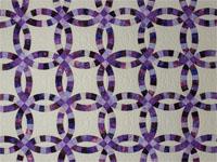 King Wedding Ring charming raspberry, purple, and lilac fabrics in batiks