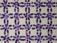 QUEEN SIZE BED Wedding Ring charming raspberry, purple, and lilac fabrics in batiks