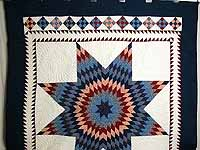 Navy and Burgundy Star of Bethlehem Quilt