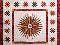 Red Green and Gold Mariner Compass Quilt