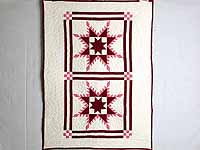 Burgundy Feathered Edge Star Crib Quilt