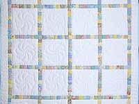 Pastel Postage Stamp Squares Crib Quilt