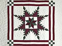Burgundy and Green Feathered Edge Star Crib Quilt