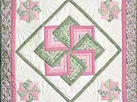 Pink and Green Star Spin Wall Hanging