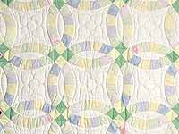 Green and Yellow Pastel Double Wedding Ring Crib Quilt