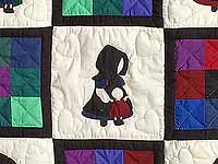 Amish Girl with Doll Nine Patch Crib Quilt