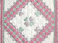 Pink Green and Lavender Hearts Trip Around the World Crib Quilt