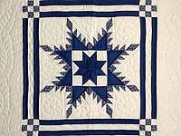 Navy and Cream Feathered Edge Star Crib Quilt