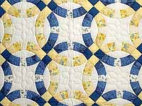 Blue and Yellow Double Wedding Ring Crib Quilt