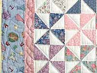 Pastel Blue and Pink Pinwheels Crib Quilt