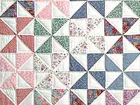 Pastel Pink and Multicolor Pinwheel Crib Quilt