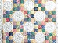 Pastel Snowball Crib Quilt