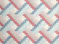 Blue and Pink Weavers Fever Crib Quilt
