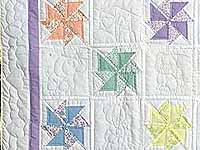Pastel Lavender and Multicolor Pinwheels Crib Quilt