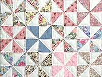 Pastel Green and Multicolor Pinwheel Crib Quilt