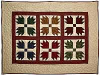 Burgundy Tan and Multicolor Bears Paw Wall Hanging