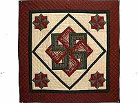 Burgundy Green and Tan Star Spin Wall Hanging