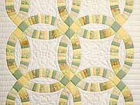 Fine Yellows and Greens Double Wedding Ring Crib Quilt