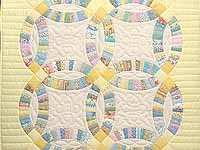 Fine Yellow and Pastel Double Wedding Ring Crib Quilt