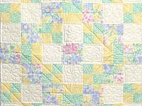Pastel Four Patch Crib Quilt