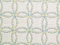 Pastel Blue and Yellow Double Wedding Ring Quilt