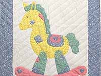 Pastel Blue and Pink Rocking Horse Crib Quilt