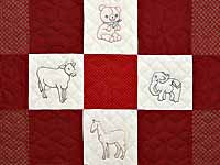 Red and Cream Embroidered Animals Crib Quilt