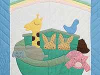 Pastel Blue and Pink Noah's Ark Crib Quilt