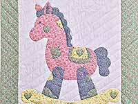 Pastel Green and Yellow Rocking Horse Crib Quilt