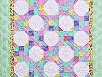 Pastel Green and Yellow Snowball Crib Quilt
