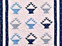 Navy Blue and Cream Baskets Crib Quilt