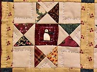 Miniature Ohio Stars with Snowmen Quilt