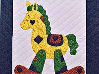 Navy and Rusty Red Rocking Horse Crib Quilt