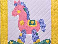 Yellow and Green Rocking Horse Crib Quilt