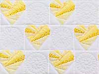Yellow and Cream Patchwork Hearts Crib Quilt