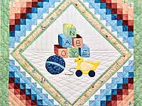 Green and Pastel ABC Crib Quilt