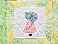 Pastel Green and Yellow Sunbonnet Sue Crib Quilt
