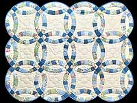 Blue and Cream Double Wedding Ring Crib Quilt