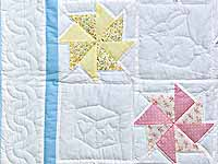 Pastel Blue and Multicolor Pinwheels Crib Quilt