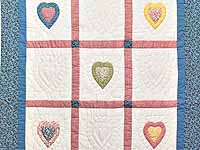 All Hearts Naive Crib Quilt