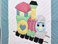 Pastel Blue and Pink Thomas Train Crib Quilt