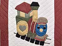Red and Multicolor Thomas Train Crib Quilt